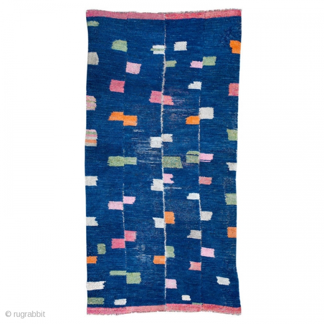 This antique Tibetan Tsutruk rug exhibits the playfulness and creativity of Tibetan nomads.  Constructed in four strips woven on a narrow backstrap loom and joined together, this rug has a unique design of  ...