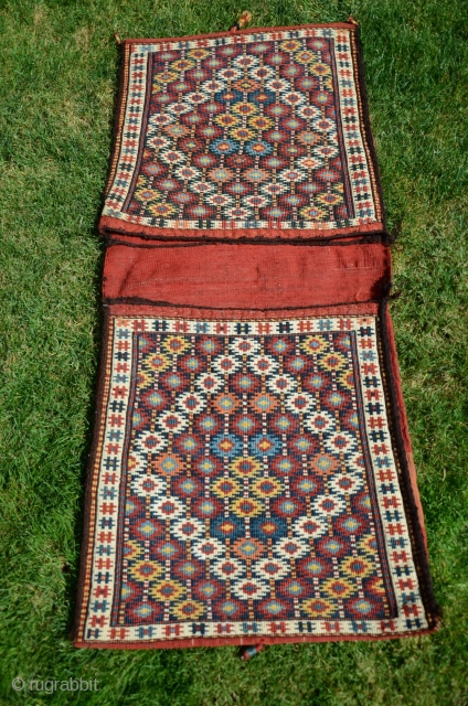 """Kordi flatwoven khorjin 4' X 1'9"""". Circa 1900. Wool. Beautiful natural colors. Lain District, Khorasan. Reciprocal brocade. Excellent condition. For comparison see Stanzer's """"Kordi"""" pp.186-187."""