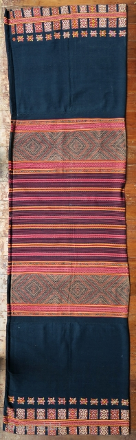 Timor ceremonial tubeskirt (tais mabuna)  Origin: Indonesia, West Timor, Biboki, 1920-1940  Technique: Handspun cotton, natural indigo and morinda dyes, commercial silk thread in synthetic dyes, warp ikat, supplementary weft wrapping (buna)  Description: A complex traditional  ...