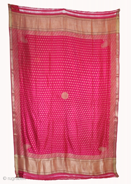 """Odhni or veil woven on a 60"""" wide loom in the 19th century .The pattern is made up of kairi,paisley, placed as a konia at the corners of the pallu.The broad plain  ..."""