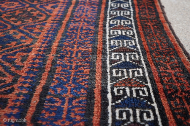 Really soft older Baluch rug or runner about 4ft x 8ft. It has really soft wool. It's in full pile with one spot near a corner with a couple knots missing. The  ...
