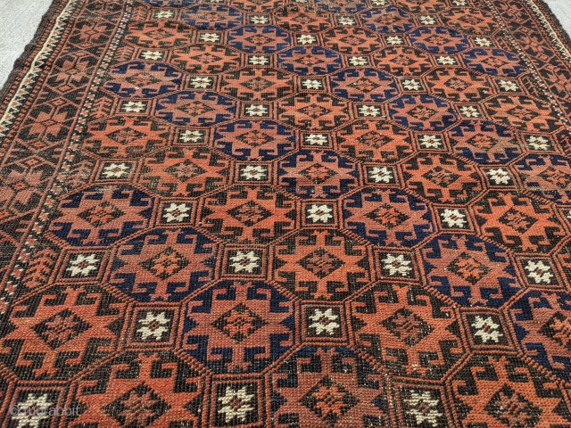 Antique Baluch rug with intact kilim ends. Memling gul design. Beautiful colors and indigo blue. Reasonable price. 6ft 7in x 3ft 8in