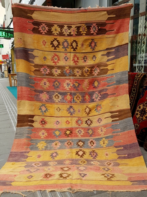 Size: 150 x 250 (cm), Kilim was purchased from a house in Nevsehir. The Bedik tribe lived in this region. The landlord says that this carpet is inherited from the 3rd generation grandfather.  ...