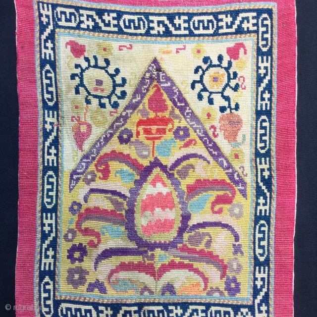 Oina khalta  with an inscription on the mihrab,19 th cent.silk embroidery on cotton,Cm.32x42,very good condition,mounted on a stretcher.