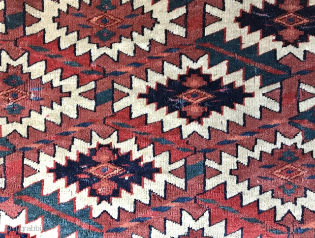 An antique fragment of an excellent Turkoman / Turkmen Yomud / Yomut Asmalyk. It has a very tight weave. Exceptional natural colours. I love the petrol. Lovely drawing. Condition is a secured  ...