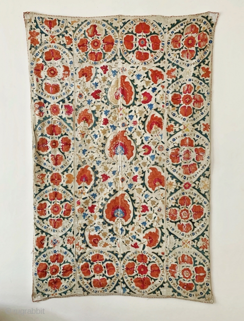 A beautiful antique Uzbek silk suzani from 19th century Bukhara. Boasting a rich floral field design with an array of palmettes, interspersed with vines and smaller floral repertoires. The borders have large  ...
