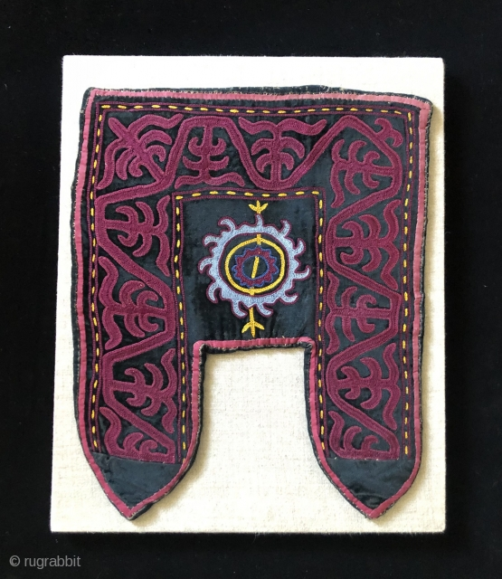 Khirgiz decorative felt stirrup cover.  20th century. Probably for ceremonial usage.   It was constructed using a natural brown, wool felt base, then applied with black velvet cloth and embroidered  ...