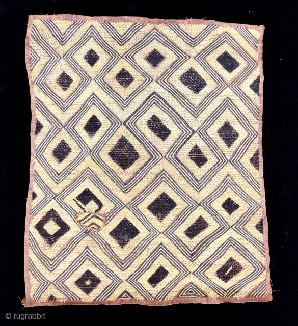 """Kuba raffia cut pile man's status cloth.  Probably Bushong people. This example has a large scale graphic with """"primitive"""" feel with its characteristically loosely tufted cut pile.  The colors are  ..."""