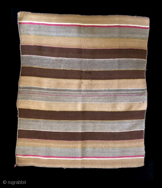 Warp-face woven ceremonial coca cloth (incuna).  Aymara indigenous group, Bolivian Altiplano region.  Mid 19th century.  This piece was woven mostly of undyed yarns in brown, tan, white and mixed  ...