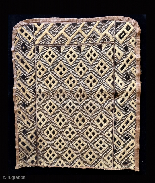 One panel of a two panel cut pile raffia cloth ceremonial dance skirt.  Beautifully made with an elegant surface and unusually balanced design.  This is an old piece with character.  ...