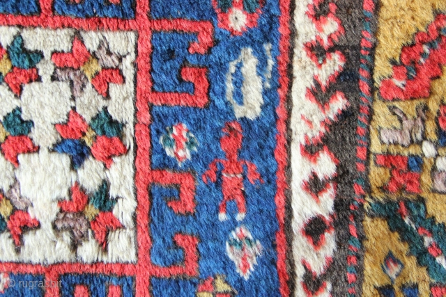 """Early Karachopf Kazak fragment, circa 1825-50. Blue ground examples are extremely rare! In very good pile but with primitive repairs. 2'6"""" x 5'2"""""""