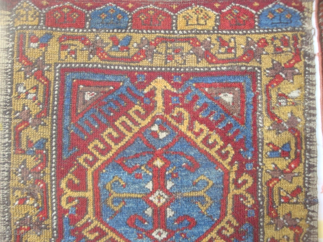 Antique Central Anatolian yastik, original side finish and kilim at top, lower end incomplete. A faded purple may be fuchsine. Priced accordingly.