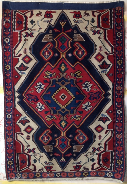 antique Bijar Kurd kilim with superb colors and interesting animals. Missing top border replaced by blue denim strip.