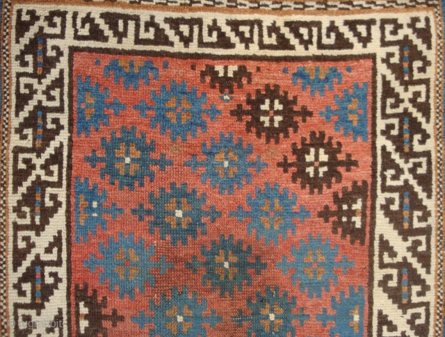 Small Avar Rug, Stars on Coppery Red Madder, Single Ivory border with archaic fret repeat, late 19/early 20 c.