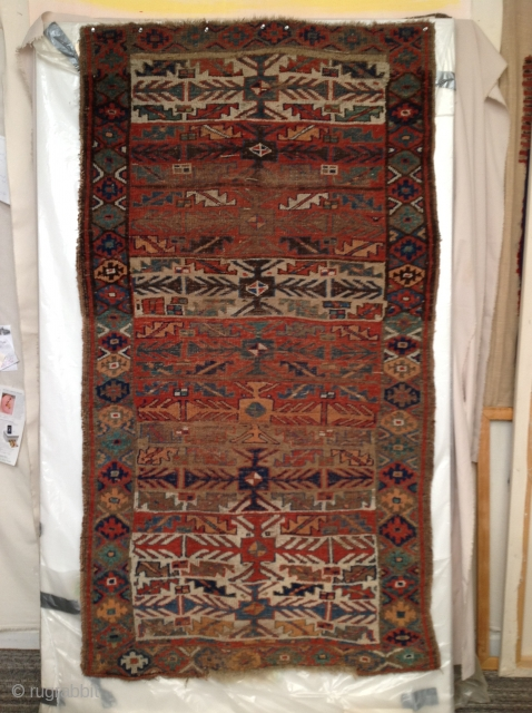 NorthWest Persian Kurd 9-stage rocket, 41 x 74 inches. Mostly even wear, some corroded brown areas, original side finish, slight gouge at lower end. Lots of ivory wool and camel hair. A  ...