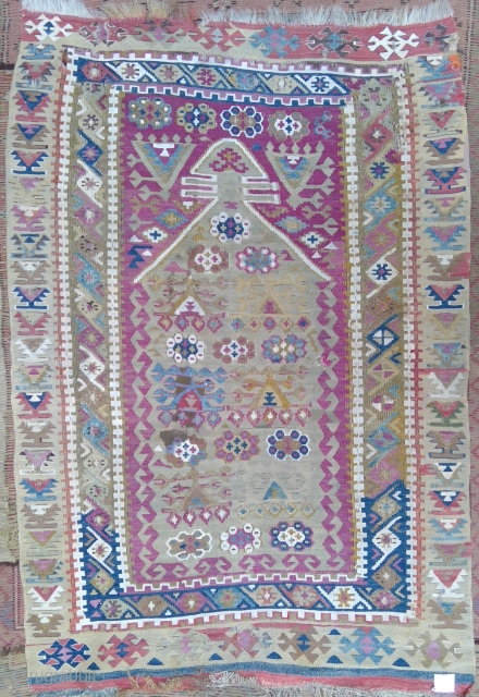 Antique Anatolian Yuruk niche kilim, (PK-073), with very fine weave, original sides and lower end finish, generations of restorations, reweaves, repairs and patches; plenty of gravitas. Priced accordingly. 36 x 53 inches.  ...