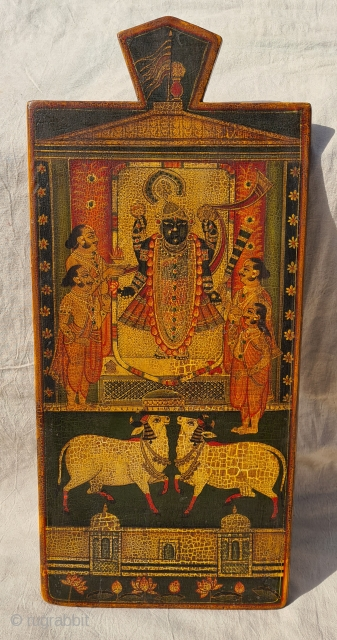 Worship of Dwarkadhishji, Kankroli. Painting on wooden panel. Late 19th -early 20th century. Nathdwara. Rajasthan, India. This was most likely the lid of a wooden box which contained the deity's jewellery or items  ...