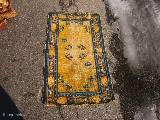 Small abused late 18th. c. Ningxia rug, it has glue on the back, nice colours.