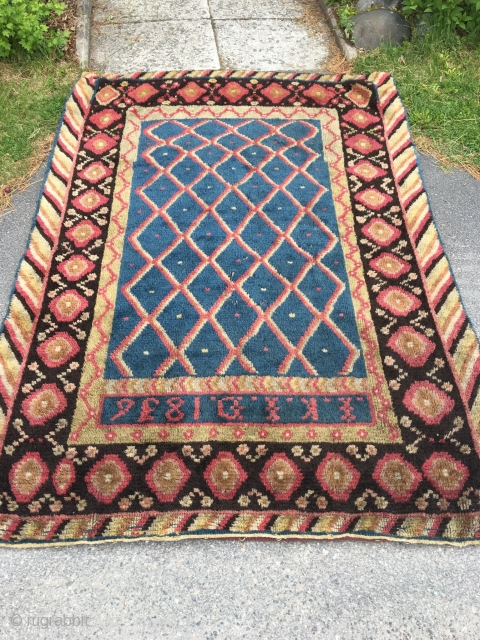 Finnish double sided wedding ryijy rug, signed and dated IKID 1836. Published as plate 5 in Finland's Ryor by U.T. Sirelius. It's in good overall condition having lost just a few knots.  ...