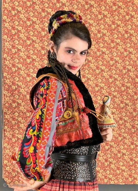 Vintage Rumanian leather applique vest and vintage Yugoslavian printed trade cloth blouse. sold seperately.