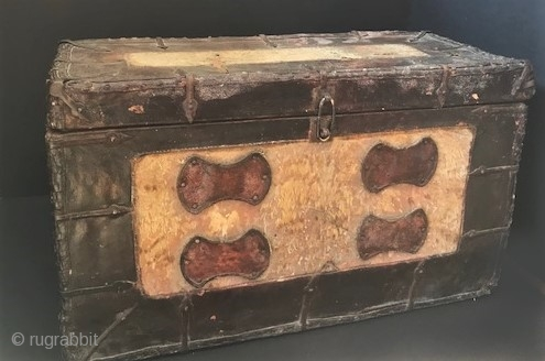 large wood and leather covered fur inlaid storage  trunk with iron fittings 18th c Tibet .