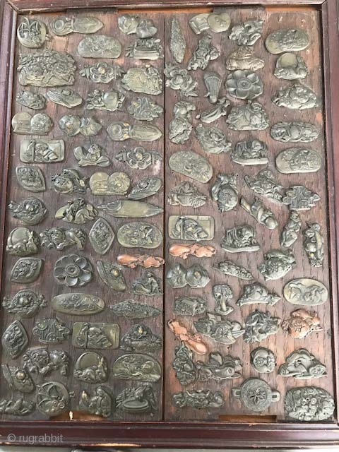 An old mounted collection of Japanese Menuki , over 100 on one board , one price.