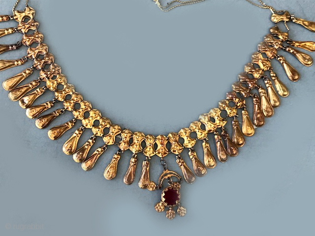 22 K Egyptian necklace with large gem center. Original necklace in design with good age and wear.