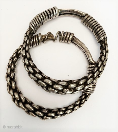 Pr of very high grade good old silver braided bangles Miao people Ghizhou province China. early 20th c