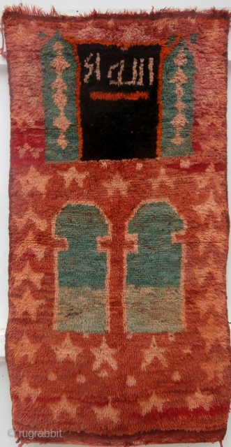 MOROCCAN BERBER INSCRIBED PRAYER RUG which is an extremely rare example from the Ait bou Ichaouen Berbers in the eastern High Atlas. I know of no other published similar rug. The attribution  ...