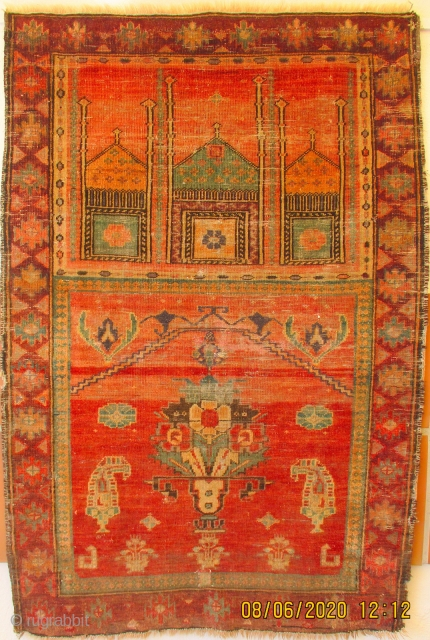 ANTIQUE PRAYER RUG FROM XINJIANG, the north west annexed province of China and home to the Uighur Moslem people.   The piece probably dates from the 3rd quarter, 19th c.   ...