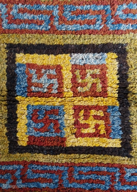 Old Tibetan Wangden rug, large khagangma square size (circa 90 by 90 cm) for monastic use, powerful five swastikas design, genuine and excellent condition, no repairs. More photos on request.