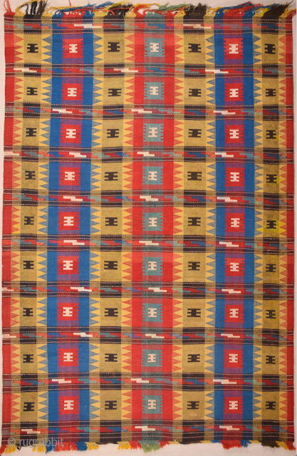 Mid 19th Century Caucasian SofrehThis large cover consists of two panels joined at the centre. It is woven in a particular technique described as balanced plain weave by Wertime; it leaves the  ...