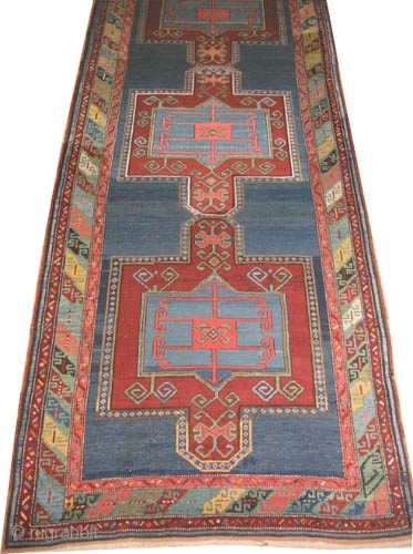 """Fachralo Kazak Caucasian knotted circa in 1910 antique. Collector's item, Size: 337 x 134 (cm) 11' 1"""" x 4' 5""""  carpet ID: H-127 The background color is indigo at the center three  ..."""