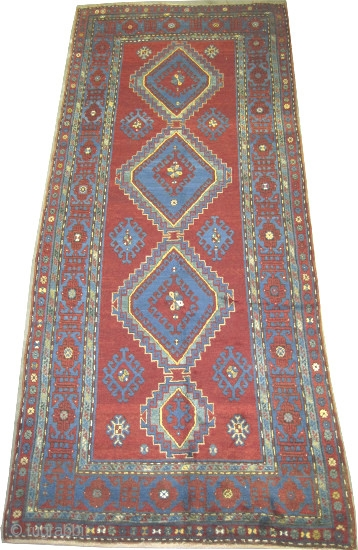 """Fachralo-Kazak Caucasian knotted circa in 1915 antique. Size: 364 x 150 (cm) 11' 11"""" x 4' 11""""  carpet ID: K-3827 The background color is warm rust with four medallions, the surrounded large  ..."""
