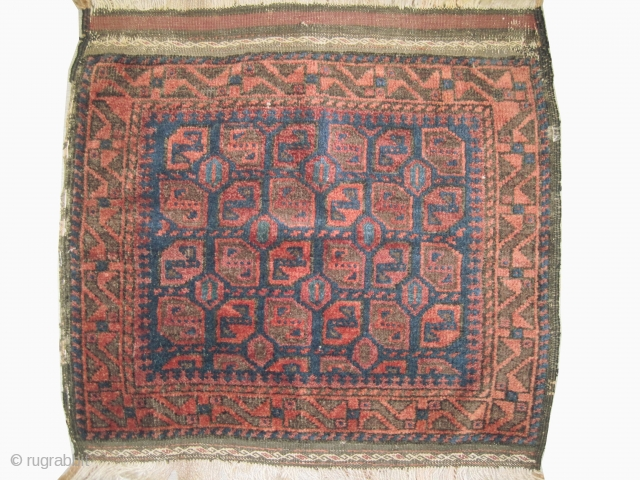 """Belutch bag face Afghanistan 1915 antique. Collector's item, Size: 69 x 34 (cm) 2' 3"""" x 1' 1""""  carept ID: MMM-10 vegetable dyes, the black color is oxidized, the knots are hand  ..."""
