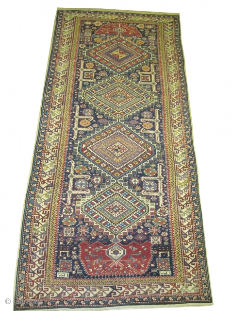 "Shirvan Caucasian antique and dated 1303 = 1885. Collectors item. Size: 334 x 150 (cm) 10' 11"" x 4' 11""  carpet ID: W-9