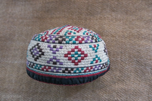 Turkmen Yomud Goklan baby hat, silk embroidery on plain cotton. Circa 1920-40s. 