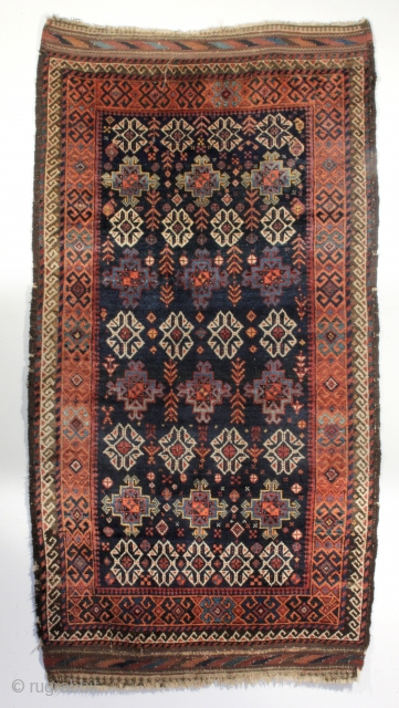 An antique Persian Khorasan Baluch Rug. Northeast Persia, circa 1900. 3-5 x 6-8 ft. Original kilim ends and sides. 