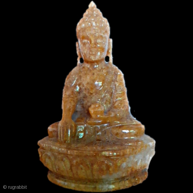 Antique yellow buddha,