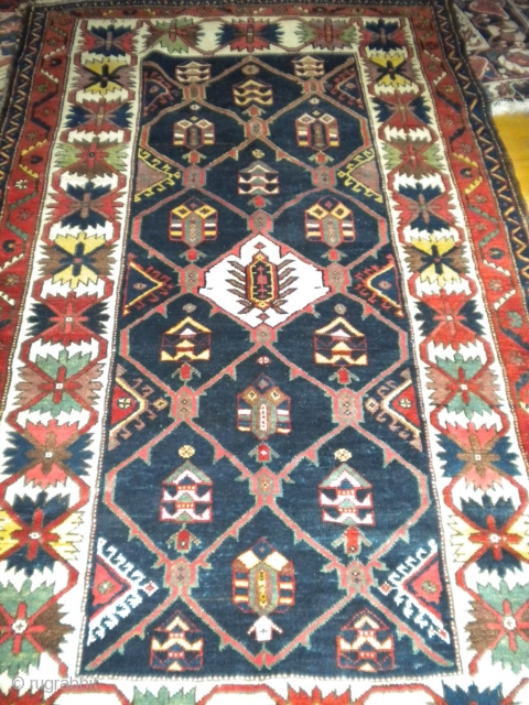 This is a beautiful tribal rug, most likely a Bakhtiari, from the early part of the 20th century, wool on wool, vegetable dye's, two low area's(see pictures), size is 4'x7', no faded  ...