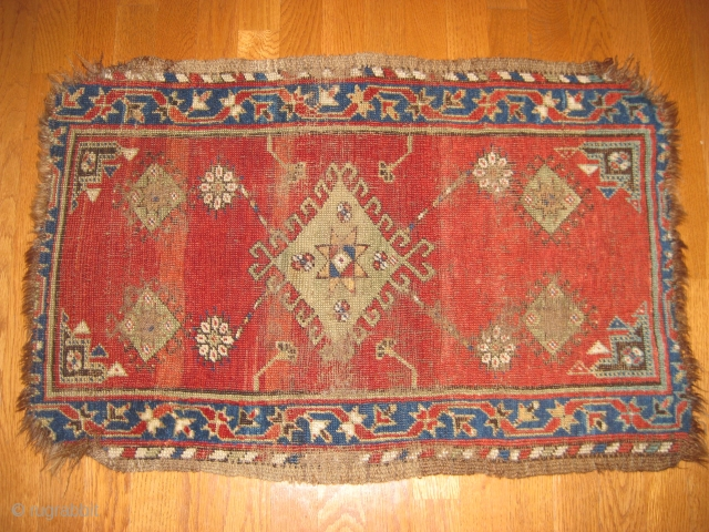 "19th C. Yastik with great natural dye colors. Corners frayed and missing several rows on ends. Medium to low pile. Size 2'8"" X 1'10""."