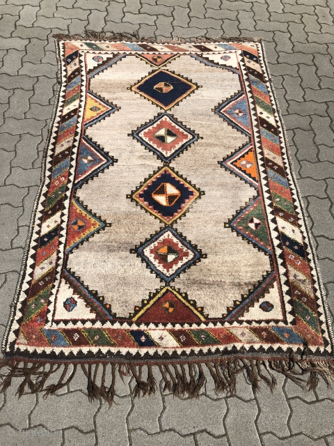 Stay at home and enjoy this lovely antique Southpersian Luri (Bakhtiary?) Gabbeh rug. Beautiful field color = undyed wool. Size: ca. 195x125cm / 6'4''ft x 4'1''ft
