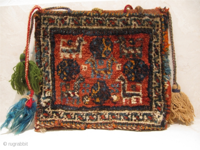 Antique Qashqai Gabbeh bag with animals.Age: circa 1900. Size: ca30x26cm. Nice collector´s piece.