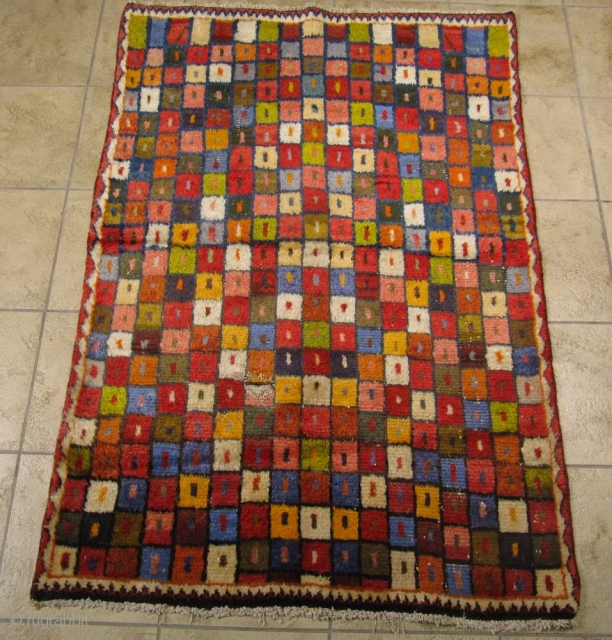 A happy Bakhtiary Gabbeh from the 1930´s. A so called Khersak rug. Size: ca. 150x103cm / 5ft x 3'4''ft www.najib.de