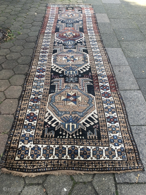 Archaic antique Northwest Persian or Caucasian long rug (Shahsavan?), expressive design, age: 19th century. Size: 403x115cm / 13'2''ft x 3'8''ft , small spots of localized wear (nothing serious), otherwise good condition.