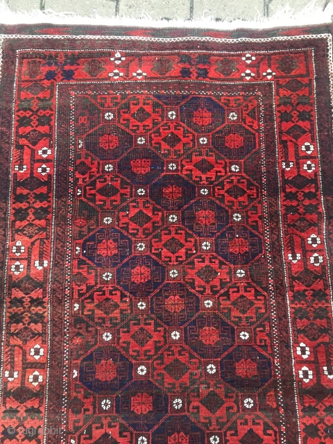 Looking for a christmas gift? a charming antique Baluch rug, beautiful design of diagonal stripes with memling gul separated by boxes of white rossettes. size: ca. 200x97cm / 6'5''ft x 3'2''ft