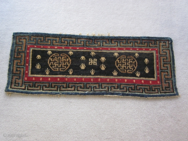 """Tibetan : Table mat with two medallions, central endless knot motif, 1'3"""" by 3'. Some repair to lower border. c.1925"""