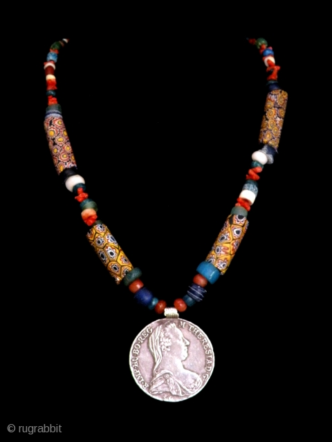 """Yemen """"Maria Teresa"""" silver  Tallero,  1780, mixed Venice Millefiori, Dutch, Blue Nile, Excavated Djenne glass  beads and old coral necklace.    Size: lenght 60 cm; diameter of  beads  ..."""