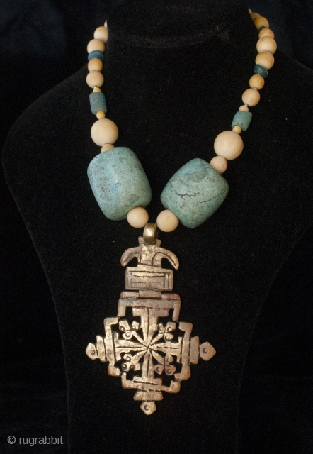 Old bronze Lalibela Coptic Cross from Ethiopia pendant insered on big old amazonite beads from Sahara, contemporary ivory and blue dutch. 