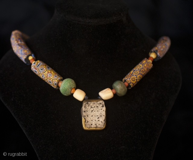 Old Berber pure chased silver and brass kitab from Ida ou Semlal, Anti Atlas, Morocco with 1850 Millefiori trade glass beads from Venice, old amazonite beads from Sahara and old coral, little  ...